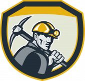 stock photo of ax  - Illustration of a coal miner hardhat holding pick axe inside a shield done in retro style - JPG