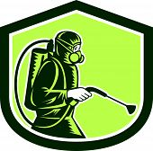 stock photo of pest control  - Illustration of pest control exterminator spraying side view set inside shield crest on isolated background done in retro style - JPG
