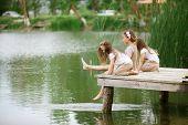 stock photo of ponds  - Children resting near pond in summer - JPG