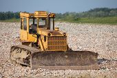stock photo of dozer  - Old dozer at a construction site - JPG