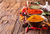 pic of mace  - Various kinds of spices on wooden planks - JPG