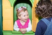 foto of montessori school  - Little child girl playing in kindergarten in Montessori preschool Class - JPG