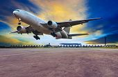 foto of air hostess  - passenger jet plane landing on air port runways against beautiful dusky sky use for travel business and air transport cargo logistid service industy - JPG