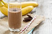 image of yogurt  - Chocolata banana smoothie in a glass with straws - JPG