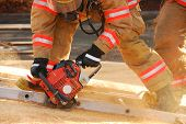 stock photo of fire-breathing  - Vertical ventilation drill behind fire station using vent saw - JPG