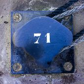 picture of bollard  - number seventy one on a blue painted metal bollard - JPG