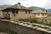 foto of old stone fence  - Old building made of stone roof tiles in Bulgaria - JPG