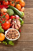 stock photo of pinto  - Pinto beans in a bowl and vegetables - JPG