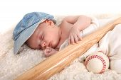 image of happy baby boy  - Infant Baby Boy Sleeping With a Baseball Bat and Ball - JPG
