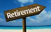 stock photo of retirement  - Retirement wooden sign with a beach on background - JPG
