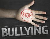 stock photo of stop bully  - Educational and Creative composition with the message Stop Bullying on the blackboard - JPG