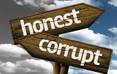 stock photo of immoral  - Honest x Corrupt creative sign with clouds as the background - JPG