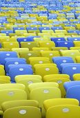 foto of bleachers  - Colored Seating rows in a Maracana stadium with weathered chairs - JPG
