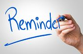 stock photo of reminder  - Reminder hand writing with a blue mark on a transparent board - JPG