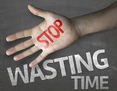 stock photo of waste management  - Educational and Creative composition with the message Stop Wasting Time on the blackboard - JPG