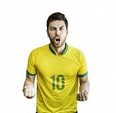 stock photo of patriot  - Brazilian soccer player celebrates isolated on white background - JPG