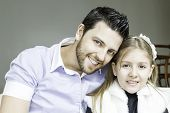 stock photo of daddy  - Daddy with his daughter having fun together - JPG