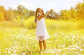 stock photo of have sweet dreams  - Summer day little girl having fun soap bubbles - JPG