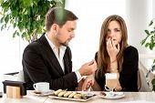 image of propose  - Man making proposal with the ring to his girlfriend at the restaurant - JPG