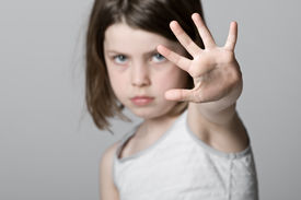 picture of hands up  - Powerful Shot of a Child with her Hand Up - JPG