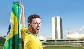 pic of brasilia  - Man holding the Brazilian flag in Brasilia - JPG