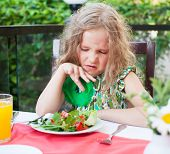 stock photo of disgusting  - Girl does not like the food - JPG