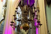 foto of chandelier  - Chandelier with candles in the cathedral Dutch city of Den Bosch - JPG