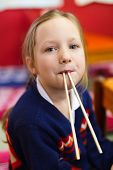 picture of chopsticks  - Portrait of adorable little girl playing with chopsticks at Japanese restaurant - JPG