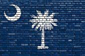 stock photo of south american flag  - flag of South Carolina painted on brick wall - JPG