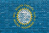 stock photo of south american flag  - flag of South Dakota painted on brick wall - JPG