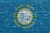 pic of south american flag  - flag of South Dakota painted on brick wall - JPG