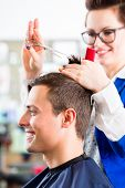 pic of hair cutting  - Female coiffeur cutting men hair in hairdresser shop - JPG