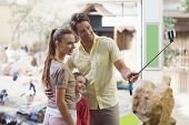 foto of zoo  - Happy family using a selfie stick at the zoo - JPG