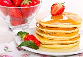 foto of maple syrup  - Pancakes with maple syrup and strawberry close up  - JPG
