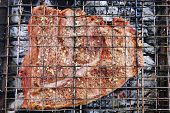 pic of spit-roast  - big roasted cooked beef steak on charcoal - JPG