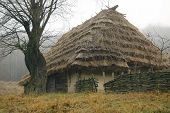 stock photo of house woods  - An old peasant house is in the museum of folk architecture and way of life - JPG