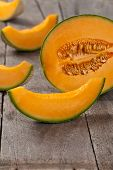 pic of muskmelon  - Fresh melons on old wooden background - JPG