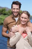 stock photo of pier a lake  - Happy couple at a lake in the countryside - JPG