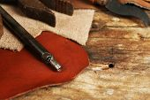 picture of leather tool  - Leather and craft tools on table close up - JPG