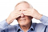 pic of blind man  - Frustrated senior man covering his eyes by hands while standing against white background - JPG