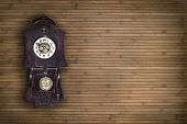 picture of pendulum clock  - old pendulum clock on the background of wooden wall - JPG