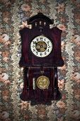 image of pendulum clock  - old wall clock with a pendulum in a retro style - JPG