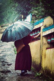 image of himachal  - Vintage retro effect filtered hipster style image of  Buddhist monk spinning prayer wheels in McLeod Ganj - JPG