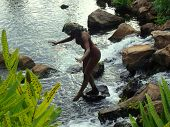 pic of hawaiian girl  - Statue of a nude Hawaiian girl in a babbling garden stream on the island of Maui - JPG