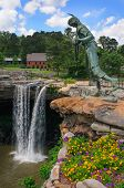 stock photo of alabama  - Beautiful Noccalula waterfall in Alabama with a statue of an indian girl - JPG
