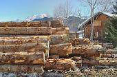 foto of chalet  - pine logs in front wooden chalet in mountain - JPG