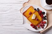 stock photo of french-toast  - French toast with honey and berries on a plate - JPG