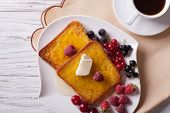 stock photo of french-toast  - hot french toast with berries and coffee on a table close - JPG