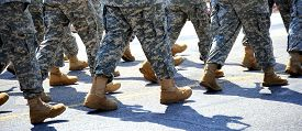 foto of army soldier  - Military army soldiers marching in a parade outdoors. ** Note: Shallow depth of field - JPG