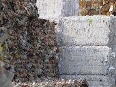 stock photo of recycled paper  - paper waste packed and ready to be recycled - JPG